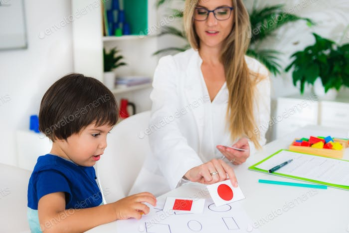 Child psychology, toddler doing logic tests with cards