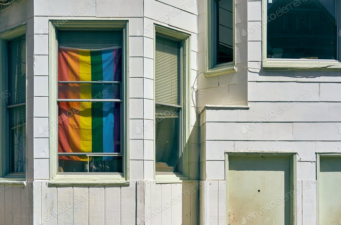 Rainbow flag in window