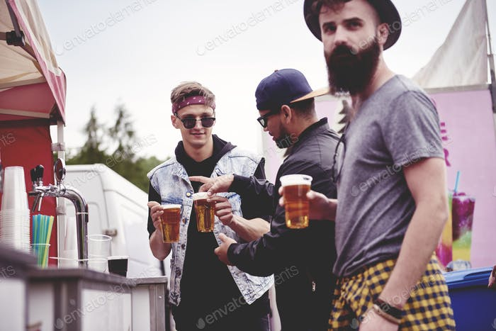 Men buying the beers at the music festival