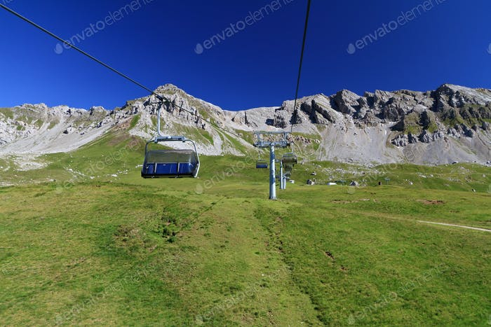 Alpine landscape with chairlift