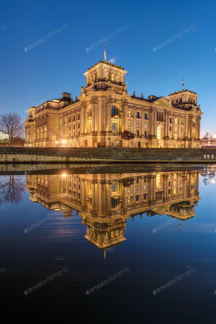 The Reichstag reflects in the river Spree