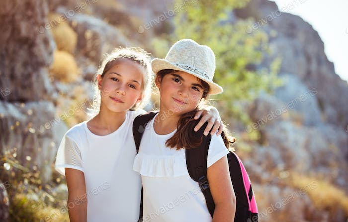Two happy girls in summer camp