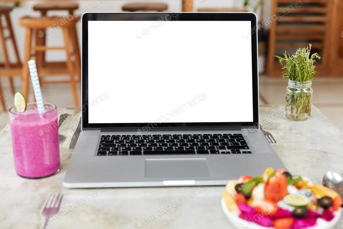 Technology and leisure concept. Modern opened portable laptop with blank white screen for your desig