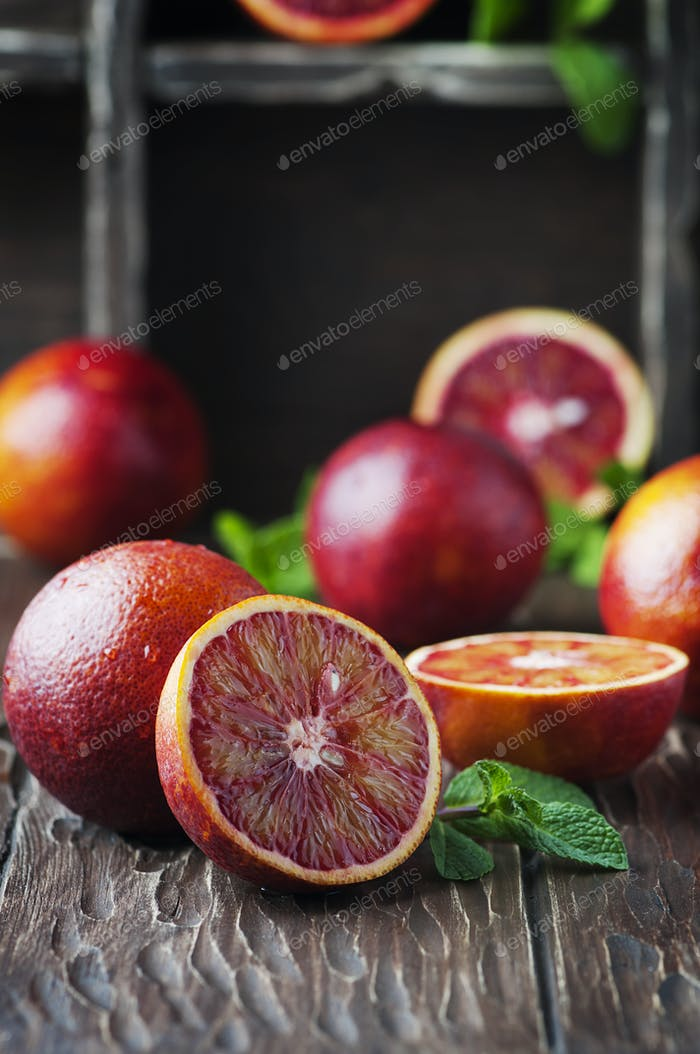 Sweet red oranges on the wooden table