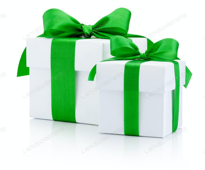 White gift boxs tied green ribbon Isolated on white background