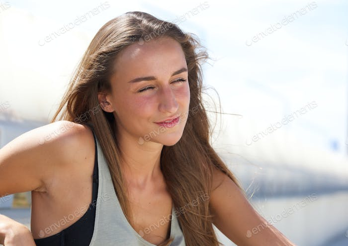 Cute young woman relaxing outside