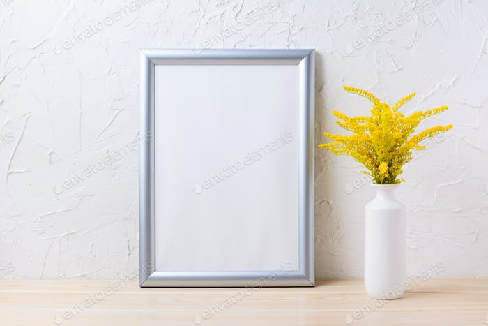 Silver frame mockup with ornamental yellow flowering grass in va