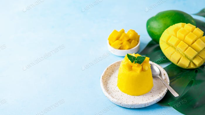 Mango Mousse on blue background, copy space
