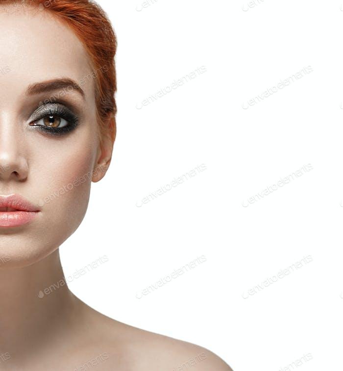 Amazing make up woman half face close up portrait isolated on white Beautiful big eyes