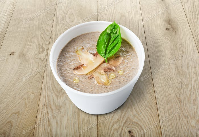 Hot food delivery - mushroom soup at wood