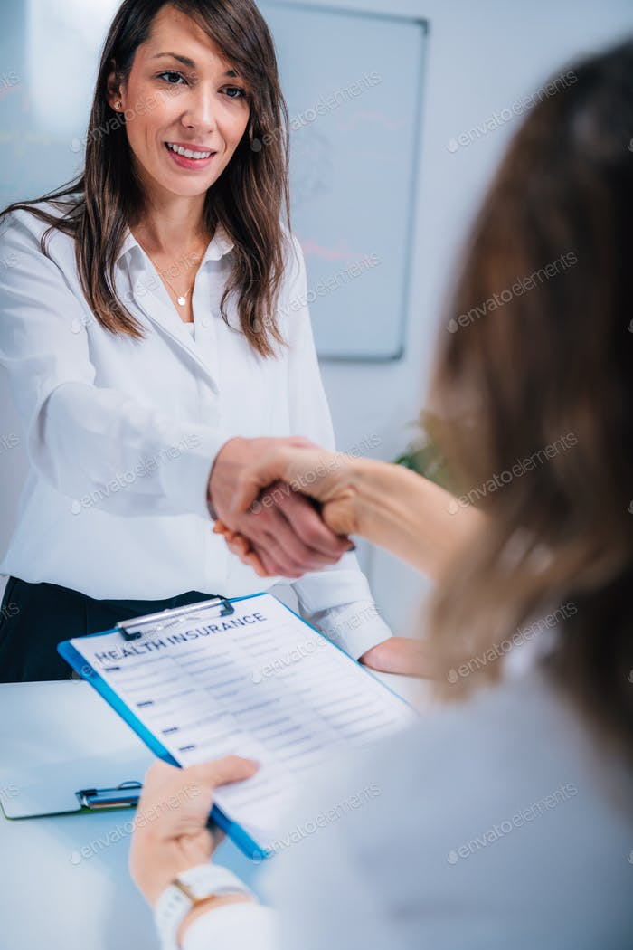 Handshake After Signing Health Insurance Form