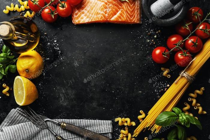 Salmon with ingredients on table