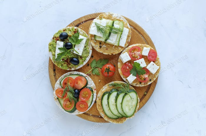 Homemade delicious appetizers on rice cakes