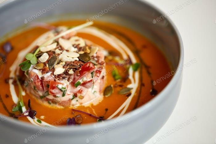close up of vegetable pumpkin-ginger soup in bowl