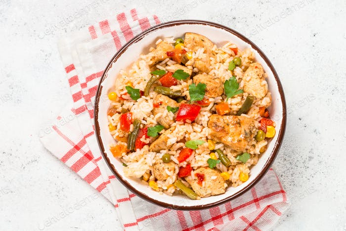 Rice with chicken and vegetables top view