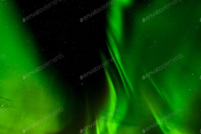 A beautiful green Aurora borealis or northern lights in Lofoten, Norway