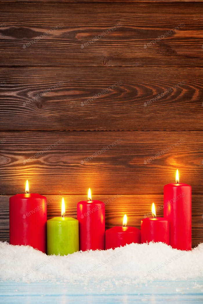 Christmas background with candles in snow
