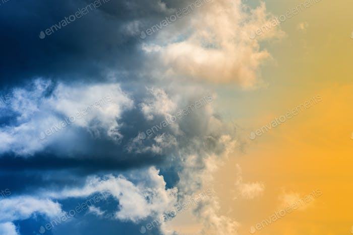 Dramatic Blue Thunderclouds, Stunning Yellow-Golden Fluffy Clouds Illuminated by Rays of Sun