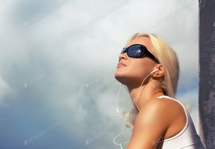 Blond female on clouds background