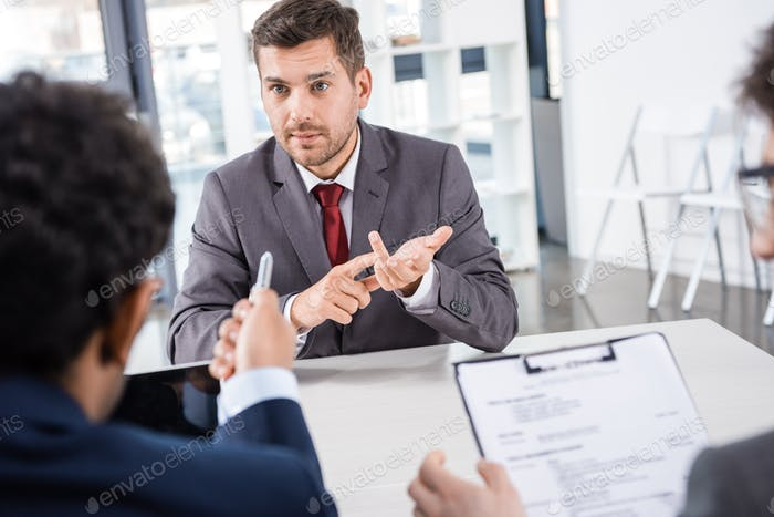 businessman counting on fingers during job interview, business concept
