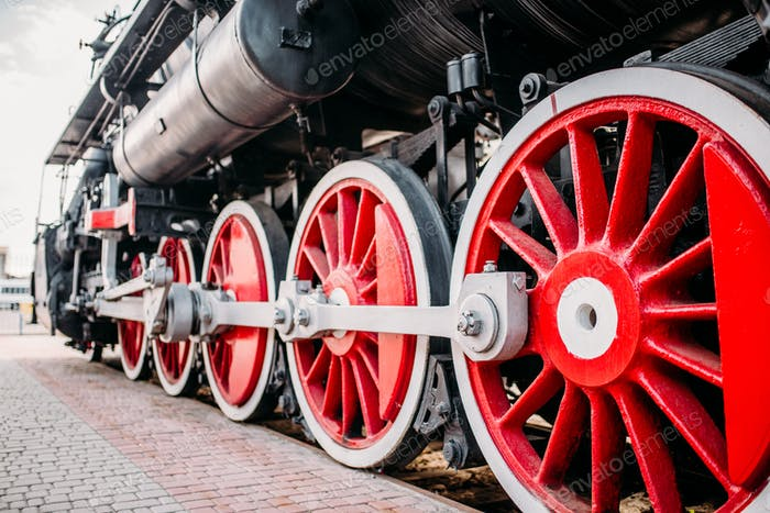 Old steam train, red wheels closeup