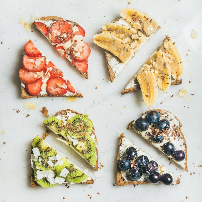 Healthy toasts with cream-cheese, fruit, nuts and seeds, square crop