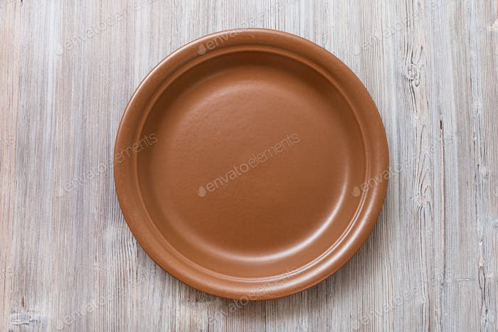above view of brown plate on gray brown table