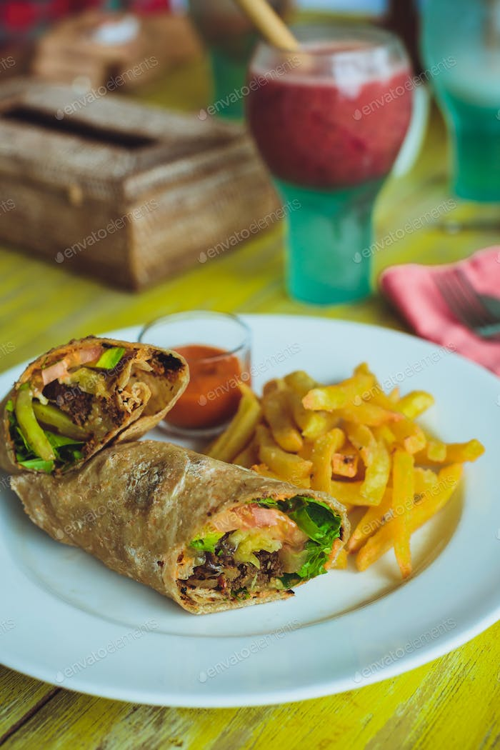 Vegetarian lunch. Vegetable rolls and fries