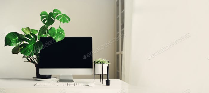 Designer workspace. Banner. Minimalistic home office. Blank screen desktop computer, Mockup desktop