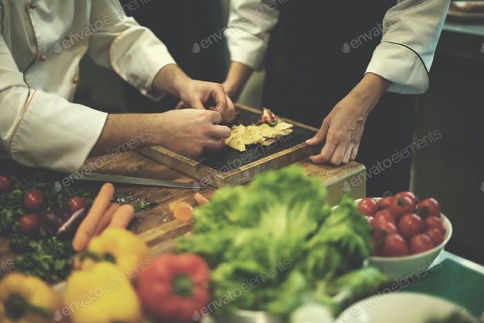 team cooks and chefs preparing meal