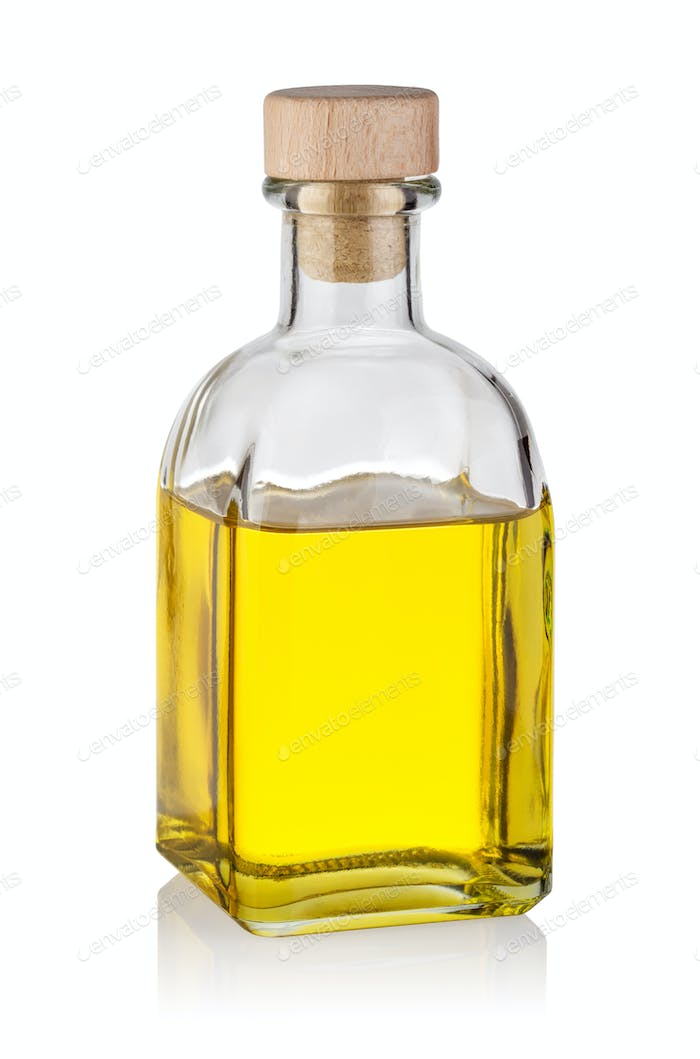 Bottle of yellow oil with wooden cork