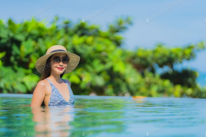 Portrait beautiful young asian woman happy smile relax in swimmi