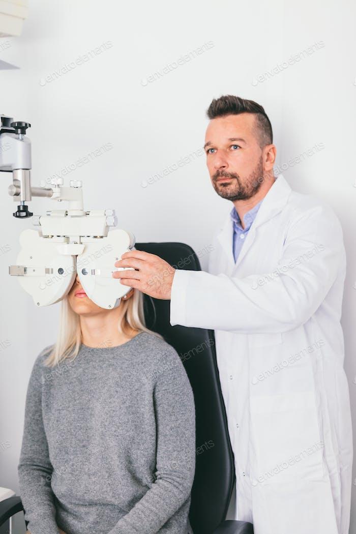 Doctor examining woman's eyesight