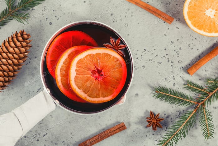 Top view on a pot with Christmas traditional beverage mulled wine with orange slices