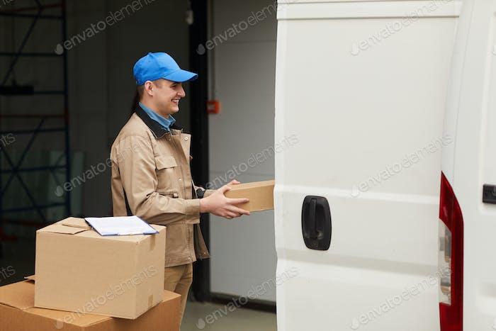 Worker loading the van