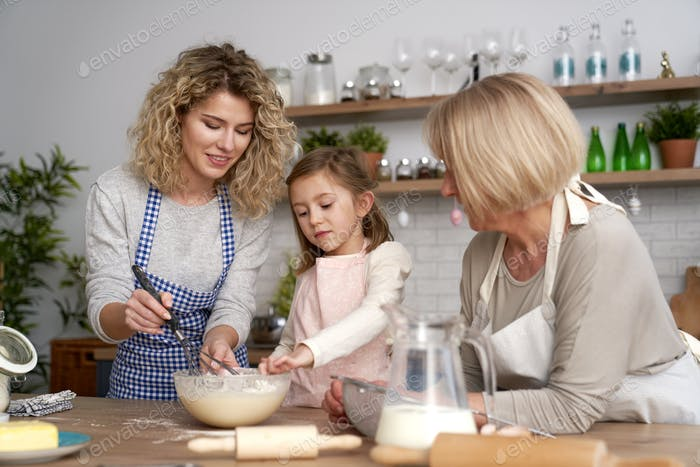 Little girl in the kitchen with her family