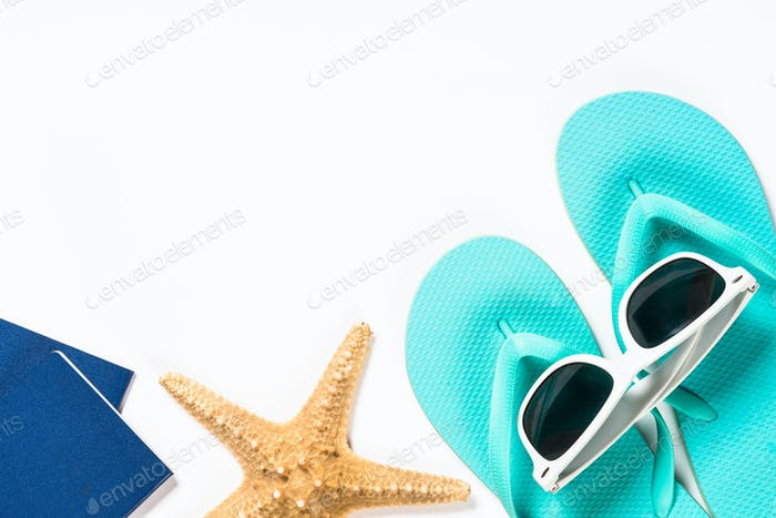Blue flip flops, sunglasses, passport and starfish on white background
