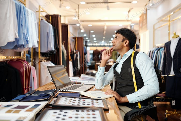 Pensive tailor in atelier
