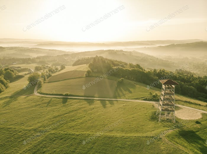Beautiful aerial view over hills at sunrise