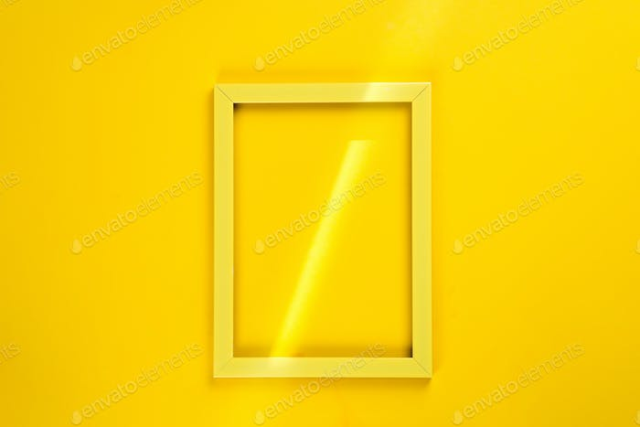 Yellow frame with a ray of sunshine isolated on yellow background with copy space, flat lay