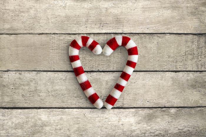Heart shape candy cane sweets flatlay
