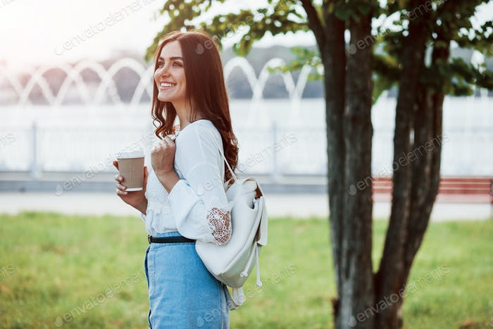Toothy smile. Young woman have good time in the park at her weekend