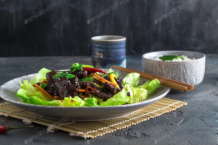 Fried turkey liver asian style with vegetables and many greens. Served with bowl of rice and tea