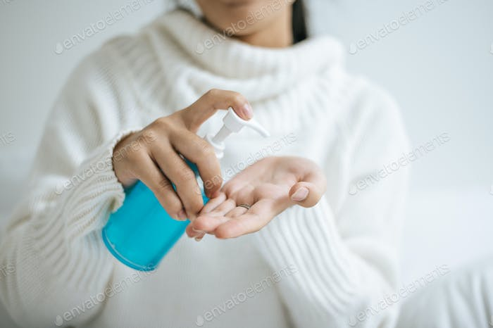 Young women wash hands with handwashing gel.