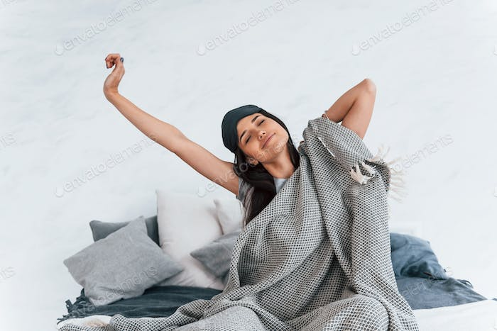 Young beautiful woman in casual clothes awake and have a good morning