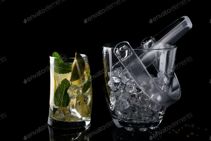 Thumbnail for Glass ice bucket and mohito cocktail in glass isolated on black