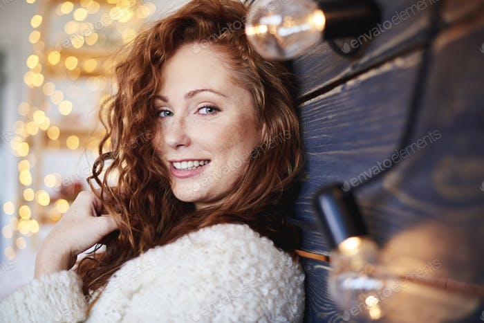 Portrait of beautiful girl spending christmas time in bed