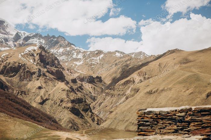 high mountains georgia rock snow top sky