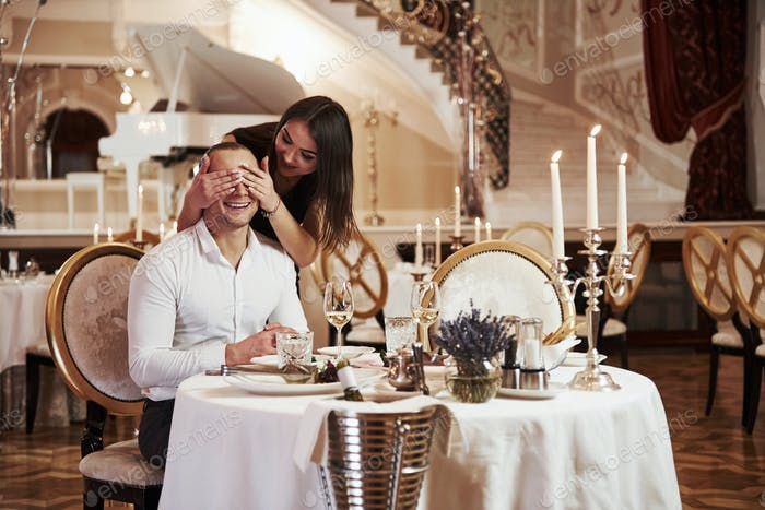 Beautiful couple have romantic dinner in luxury restaurant at evening time