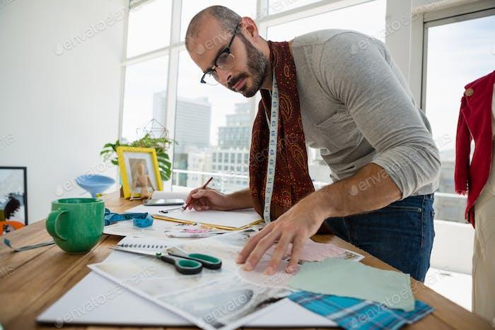 Male designer drawing sketch in workshop